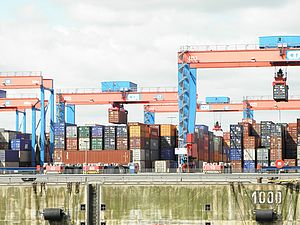 Numerous containers are standing in a container port