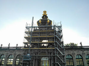 An entrance portal of the Dresden Zwinger is encased in a scaffolding